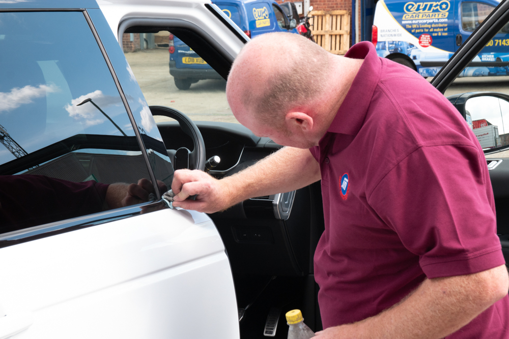 Mark from The Accident Repair Centre giving a car a final polish