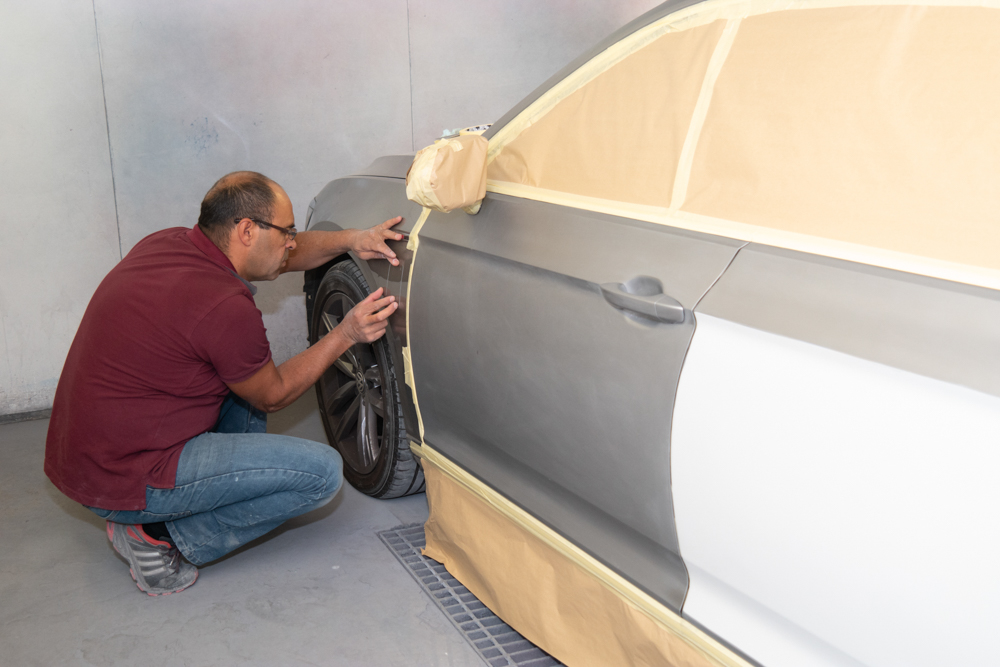 ILCO continuing to prepare a vehicle to be spray painted